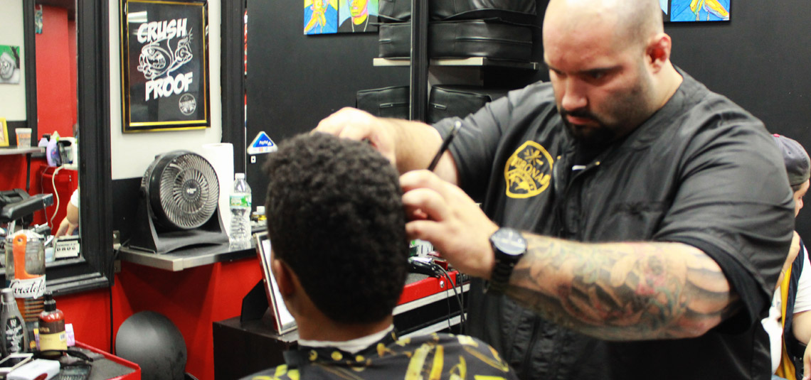Corona Barbershop Plus barber using straight razor.