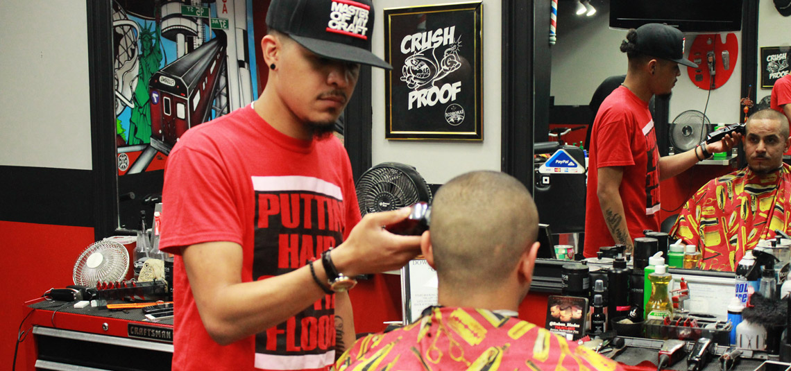 Corona Barbershop Plus barbers using clippers.